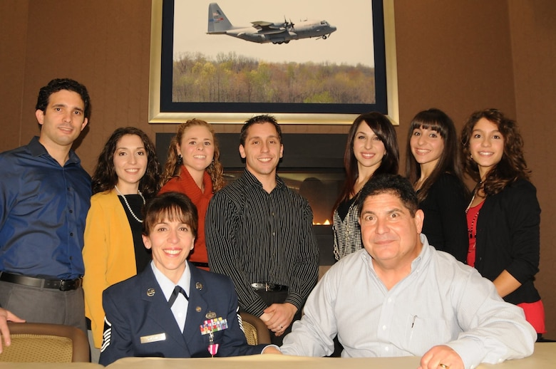 Master Sgt. Anna Marie Russo, an administrative assistant to the 910th Airlift Wing commander, poses for a photo with her family on Nov. 17, 2013, at Youngstown Air Reserve Station. Russo retired after 33 years of service in the Air Force Reserve.
