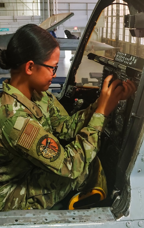 A1C Angelica Aquino works on an A-10 instrument panel