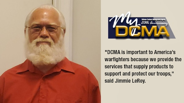 Man wearing a red shirt smiles at the camera. The My DCMA 20th anniversary logo is located in the right upper corner.