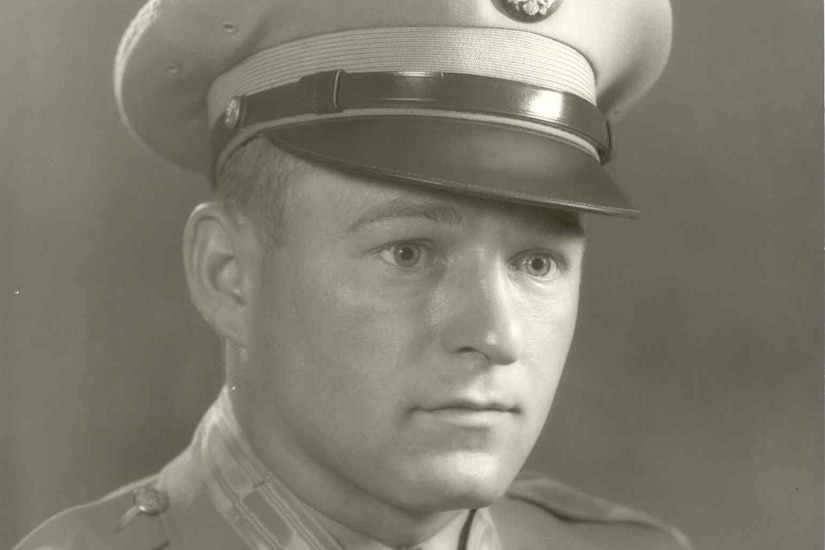 A soldier in cap and dress uniform wears the Medal of Honor.
