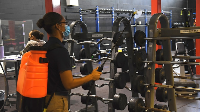 U.S. Air Force Senior Airman Esmeralda Morales, a 6th Force Support Squadron (FSS) fitness center specialist conducts a temperature check for Staff Sgt. Johari Stephens with the 6th FSS, as he enters the Short Fitness Center Sept. 2, 2020, at MacDill Air Force Base, Fla.