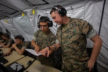 U.S. Marines with Marine Air Support Squadron 2 conduct New Equipment Training with Phase II of the Common Aviation Command and Control System aboard Marine Corps Air Station Futenma, Okinawa, Japan, Sept. 19, 2019. CAC2S modernizes aviation command and control equipment and improves interoperability among Marine Air Command and Control squadrons, Marine Air-Ground Task Force assets and joint agencies. Program Executive Officer Land Systems recently completed fielding all full rate production units of CAC2S.  (U.S. Marine Corps photo by Lance Cpl. Ethan M. LeBlanc)