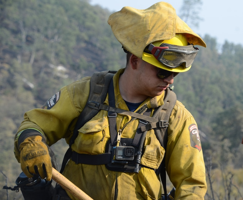 U.S. Army Spc. Daniel Rincon, a hand crew member with Fresno-based Joint Task Force Rattlesnake Alpha team, on the steep slope of Rumsey Canyon where he and other members of the California State and National Guard help try to contain the LNU Lightning Complex fire near Rumsey, Aug 30, 2020.