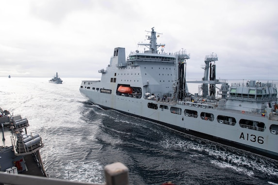 The Arleigh Burke-class guided-missile destroyer USS Ross (DDG 71) conducts a replenishment-at-sea (RAS) with British Royal Fleet Auxiliary tanker RFA Tidespring (A136) Tide-class replenishment tanker and Royal Navy frigate HMS Sutherland (F81) in the Norwegian Sea, Sept. 5, 2020.