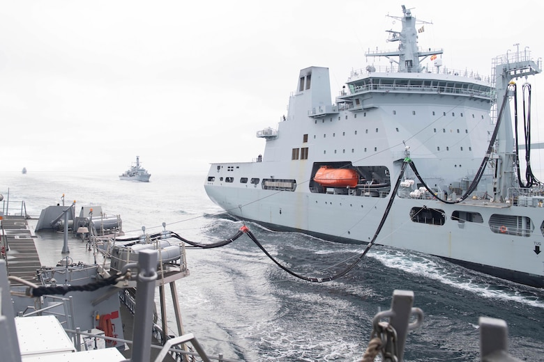 The Arleigh-Burke class guided-missile destroyer USS Ross (DDG 71) receives a fuel probe from British Royal Fleet Auxiliary RFA Tidespring (A136) Tide-class replenishment tanker, Sept. 5, 2020.