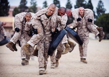 Recruits with India Company, 3rd Recruit Training Battalion, participate in the Combat Conditioning Course at Marine Corps Recruit Depot, San Diego, Sept. 2, 2020.