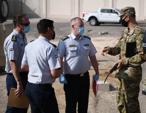 Chief Master Sgt. Christopher Brearley (right), 380th Expeditionary Civil Engineer Squadron fire chief, explains happenings in an accident scene to the United Arab Emirates first responders during the Major Accident Response Exercise (MARE) Thursday, Sept. 3, 2020 at Al Dhafra Air Base, United Arab Emirates.