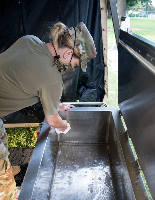U.S. Air Force Staff Sgt. Jenna Turner, 133rd Sustainment Services Flight, prepares the field sanitation unit for the Single Pallet Expeditionary Kitchen (SPEK) in St. Paul, Minn., Aug. 20, 2020.