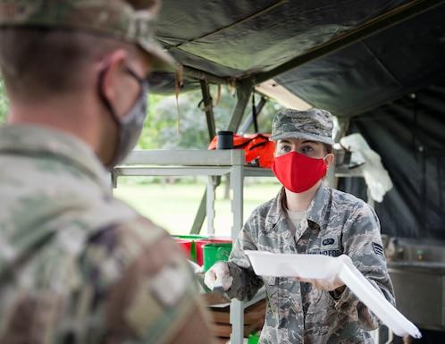 U.S. Air Force Senior Airman Andrea Cooper, 133rd Sustainment Services Flight, serves food in St. Paul, Minn., Aug. 20, 2020.