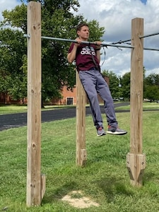Caleb Pym gets in as many pull ups as he can as part of the CFA.