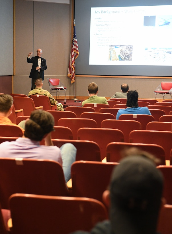 Dr. Rich Tighe, General Manager of National Aerospace Solutions, LLC (NAS) speaks about his career path during a presentation to Air Force and NAS interns, July 15, 2020, in the Main Auditorium at Arnold Air Force Base, Tenn. NAS is the Test Operations and Sustainment Contractor for AEDC. (U.S. Air Force photo by Jill Pickett)