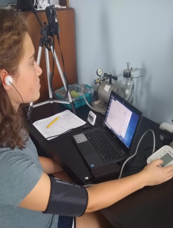 A student intern teleworking on a project involving acceleration and altitude research for her mentor at the 711th Human Performance Wing. (Courtesy photo)