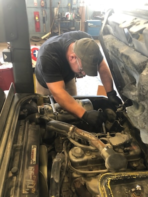 Tim Purinton, an automotive mechanic at Arnold Air Force Base, works to repair a vehicle at the Motor Pool facility. Purinton is an employee with Akima Intra-Data, an Alaskan Native small business contracted to conduct Facility Support Services for Arnold. (U.S. Air Force photo)