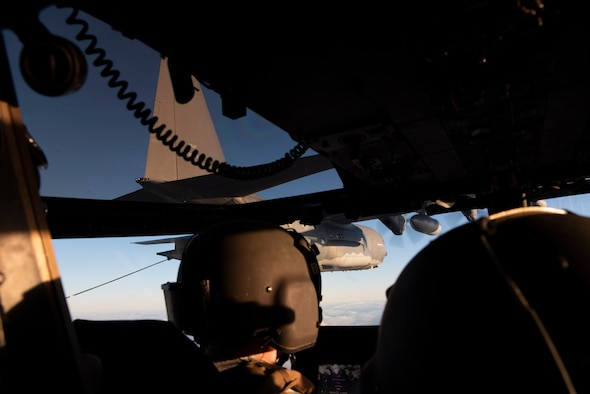 Aircrew members of a CV-22B Osprey look at a MC-130J Commando II, all based out of RAF Mild-enhall, U.K., while being aerially refueled during a training exercise near Bodø, Norway, August 27, 2020. Integration with the Norwegian Air Force allowed the 352d Special Operations Wing to enhance and strengthen bonds with our partner nation and further secure the strategic high-north region. The exercise provided training for 352d Special Operations Wing members on capabilities such as personnel recovery, forward area refueling point, aerial refueling, maritime craft delivery system, and fast rope training. (U.S. Air Force photo by Staff Sgt. Michael Washburn)