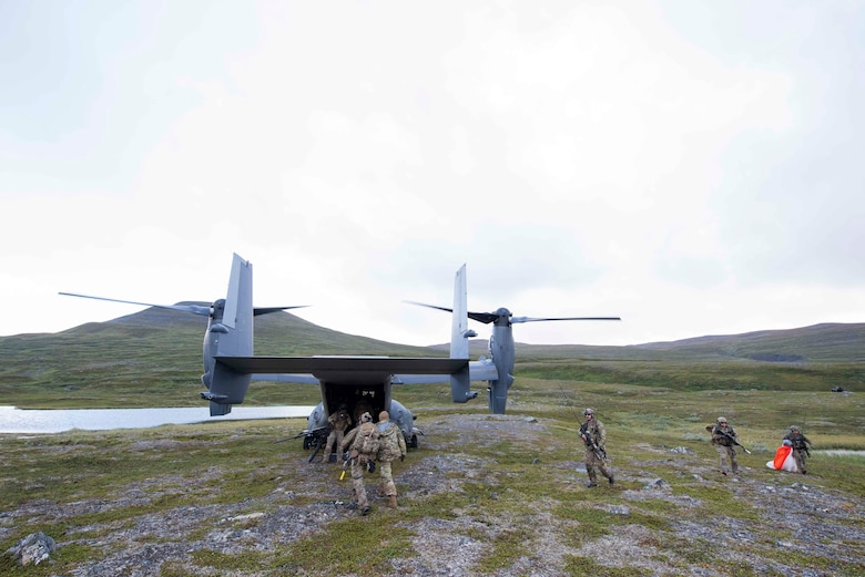 321st Special Tactics Squadron Airmen return a simulated downed crew member back to a CV-22B Osprey, based out of RAF Mildenhall, U.K., during a training exercise near Bodø, Norway, August 27, 2020. Integration with the Norwegian Air Force allowed the 352d Special Operations Wing to enhance and strengthen bonds with our partner nation and further secure the strategic high-north region. The exercise provided training for 352d Special Operations Wing members on capabilities such as personnel recovery, forward area refueling point, aerial refueling, maritime craft delivery system, and fast rope training. (U.S. Air Force photo by Staff Sgt. Michael Washburn)