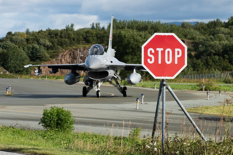 A Royal Norwegian Air Force F-16 Fighting Falcon prepares  to enter the Rygge Air Station, Norway, flightline before a training exercise, August 26, 2020. Integration with the Norwegian Air Force al-lowed the 352d Special Operations Wing to enhance and strengthen bonds with our partner nation and further secure the strategic high-north region. The exercise provided training for 352d Special Opera-tions Wing members on capabilities such as personnel recovery, forward area refueling point, aerial refu-eling, maritime craft delivery system, and fast rope training. (U.S. Air Force photo by Staff Sgt. Mi-chael Washburn)