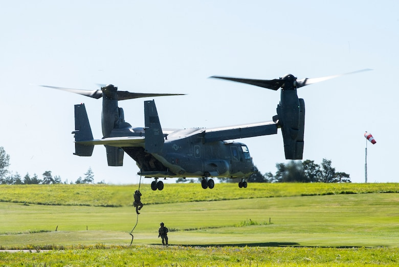 321st Special Tactics Squadron Airmen repel from a CV-22B Osprey, based out of RAF Mildenhall, U.K., during a training mission at Rygge Air Station, Norway, August 25, 2020. Integration with the Norwegian Air Force allowed the 352d Special Operations Wing to enhance and strengthen bonds with our partner nation and further secure the strategic high-north region. The exercise provided training for 352d Special Operations Wing members on capabilities such as personnel recovery, forward area refuel-ing point, aerial refueling, maritime craft delivery system, and fast rope training. (U.S. Air Force photo by Staff Sgt. Michael Washburn)