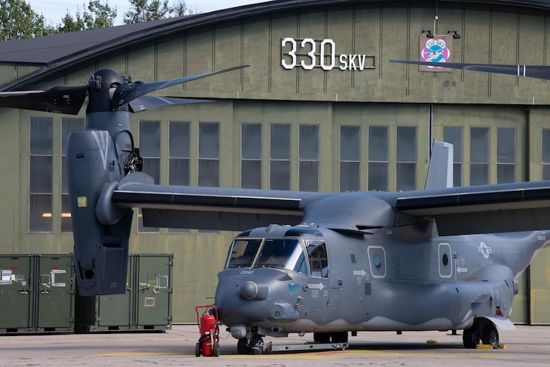 A CV-22B Osprey, based out of RAF Mildenhall, U.K., sits parked on the flightline outside a Norwe-gian hangar at Rygge Air Station, during a training mission, August 25, 2020. Integration with the Norwegian Air Force allowed the 352d Special Operations Wing to enhance and strengthen bonds with our partner nation and further secure the strategic high-north region. The exercise provided training for 352d Special Operations Wing members on capabilities such as personnel recovery, forward area refuel-ing point, aerial refueling, maritime craft delivery system, and fast rope training. (U.S. Air Force photo by Staff Sgt. Michael Washburn)
