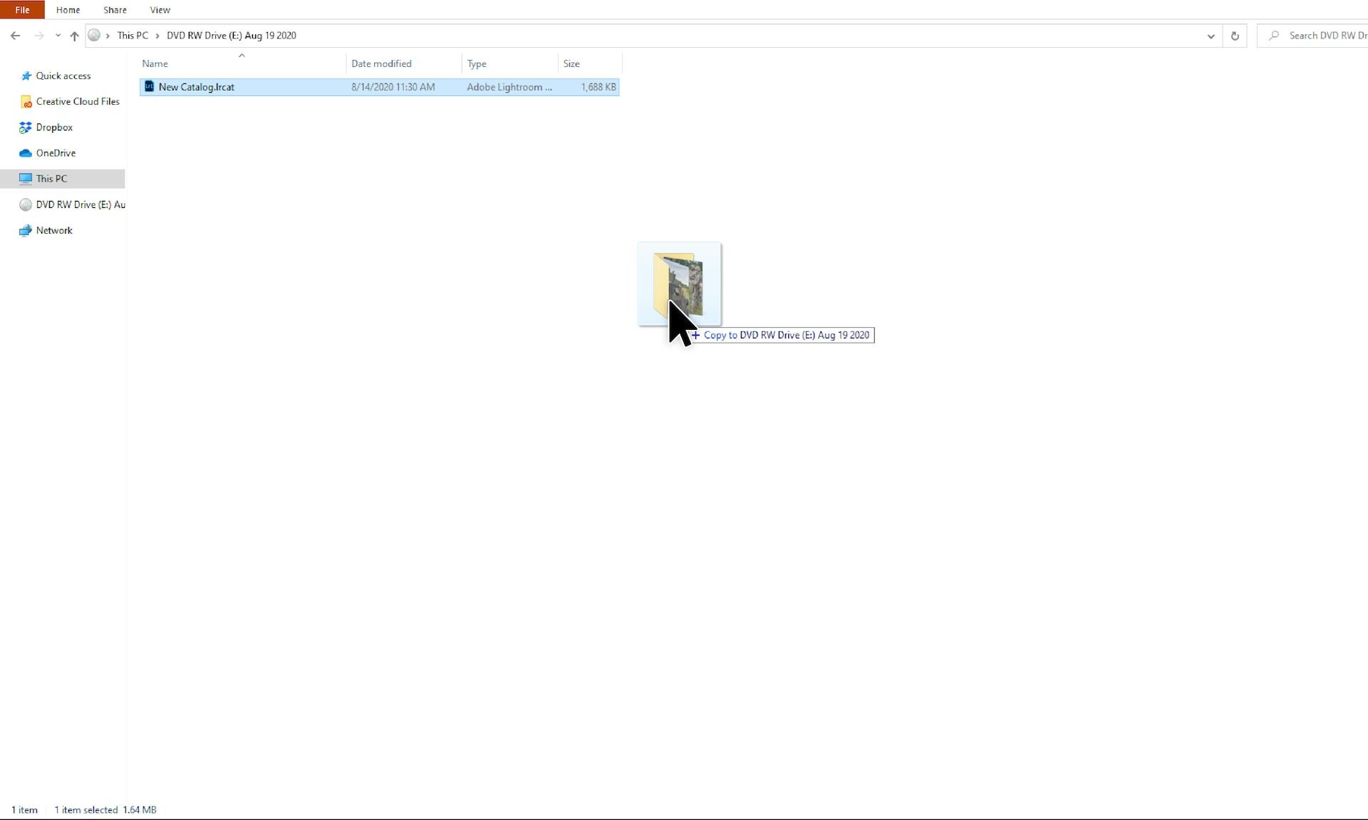Screenshot of Adobe Lightroom with the project folder highlighted inside disc drive folder.