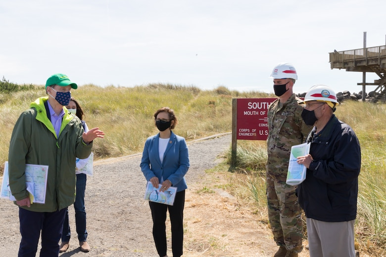 Senator Ron Wyden and Reps. Suzanne Bonamici and Jaime Herrera Beutler attend a small commemoration event at the South Jetty at the Mouth of the Columbia River to see what their legislative funding efforts are supporting, Aug. 31. The Corps estimates that it will complete rehabilitation on South Jetty by 2024 and will use 400,000 tons of stone. (U.S. Army photo by Jeremy Bell)