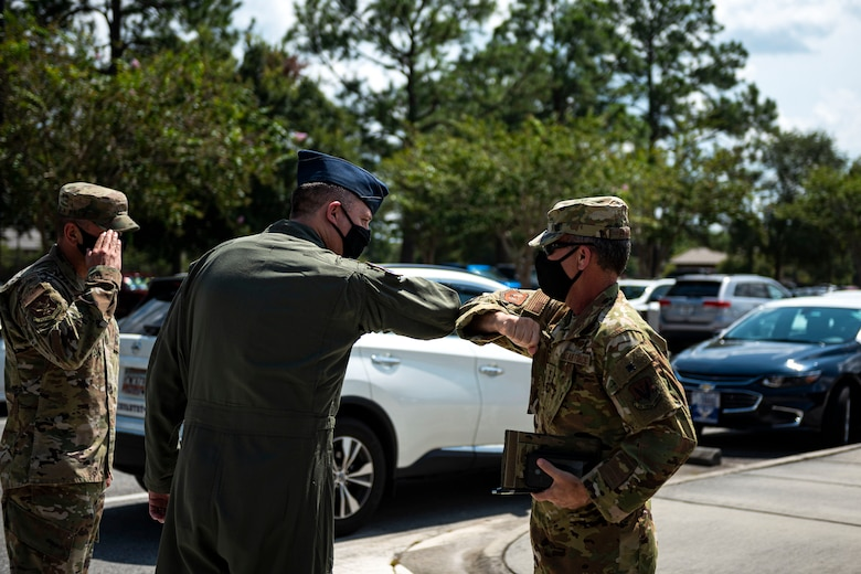 Photo of commanders greeting each other.