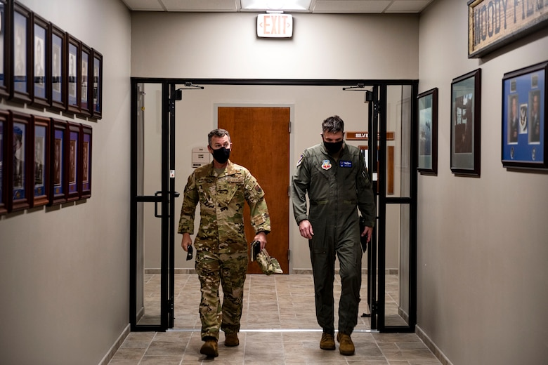 Photo of commanders walking and talking.