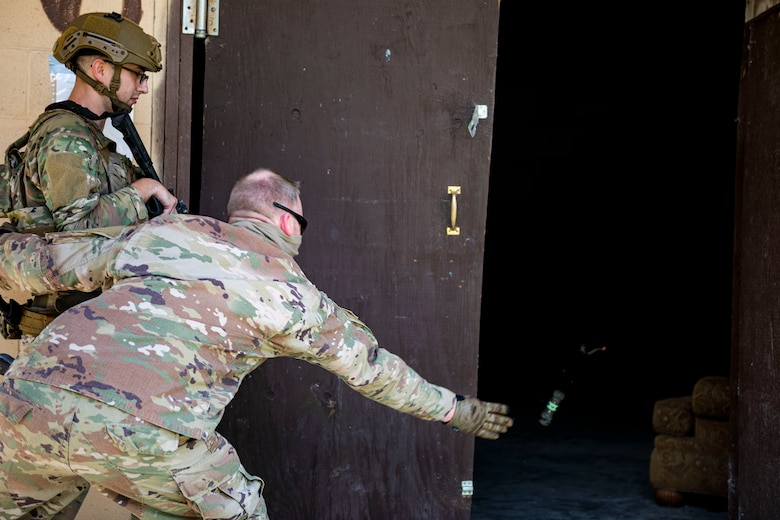 Photo of command chief throwing a flash-bang.