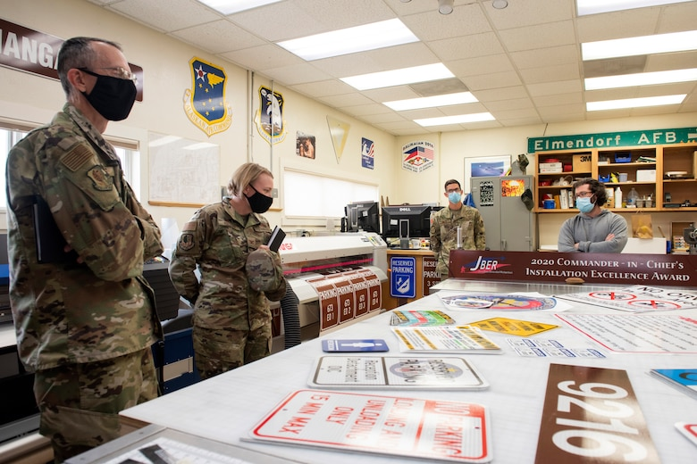 U.S. Air Force Chief Master Sgt. Lee Mills, left, Joint Base Elmendorf-Richardson and 673d Air Base Wing command chief, and U.S. Air Force Col. Kirsten Aguilar, JBER and 673d ABW commander, look at signs during a 773d Civil Engineer Squadron immersion tour at JBER, Alaska, Sept. 1, 2020. Aguilar familiarized herself with the 773d CES and its role in supporting installation readiness after taking command of the installation on July 14, 2020. The 773d CES maintains structures throughout the base as well as runs the installation's emergency management program.