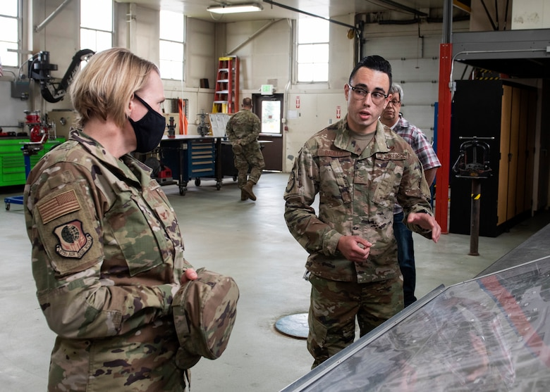 U.S. Air Force Airman 1st Class Matthew Badillo, a 773d Civil Engineer Squadron water and fuels system maintenance apprentice, briefs U.S. Air Force Col. Kirsten Aguilar, Joint Base Elmendorf-Richardson and 673d Air Base Wing commander, on liquid fuels facilities during a 773d CES immersion tour at JBER, Alaska, Sept. 1, 2020. Aguilar familiarized herself with the 773d CES and its role in supporting installation readiness after taking command of the installation on July 14, 2020. The 773d CES maintains structures throughout the base as well as runs the installation's emergency management program.
