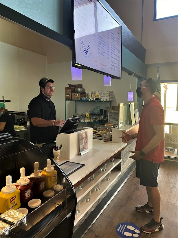 Installations, such as at Dyess AFB, Texas, are taking part in the pilot program bringing online food ordering and pick-up to NAF food locations.