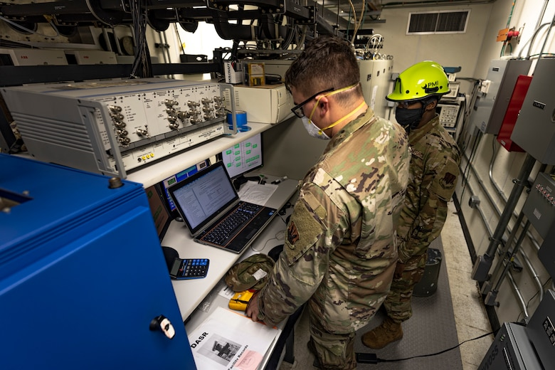 A photo of an Airman looking over technical orders