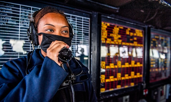 Sailor communicates with combat information center while standing watch on bridge as USS Germantown transits Luzon Strait, South China Sea, September 5, 2020 (U.S. Navy/Taylor DiMartino)
