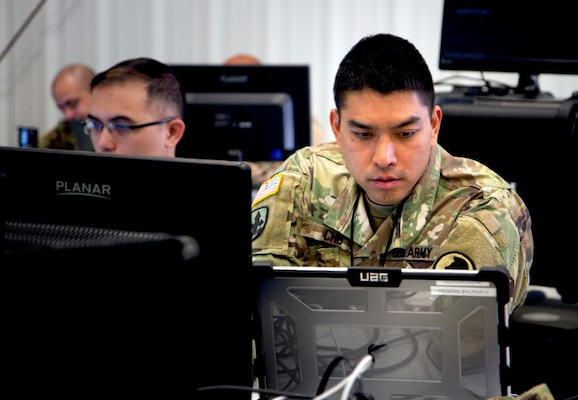 Chief Warrant Officer 3 Brandon Cho with the Hawaii Army National Guard's Cyber Mission Assurance Team participates in a cyber exercise during Cyber Shield 19 at Camp Atterbury, Indiana, April 6, 2019. Now in its 13th year, the exercise helps prepare National Guard cyber troops to defend critical infrastructure from the growing threat of cyber assaults. This years exercise, Cyber Shield 2020, will be conducted in a virtual environment due to the COVID-19 pandemic.