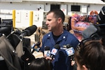 Coast Guard Cmdr. Timothy Cronin, deputy chief of enforcement for the Coast Guard 7th District, speaks to South Florida media outlets during the offload of approximately eight tons of seized cocaine from the Coast Guard Cutter Bernard C. Webber to Coast Guard Base Miami Beach on June 13, 2016.
