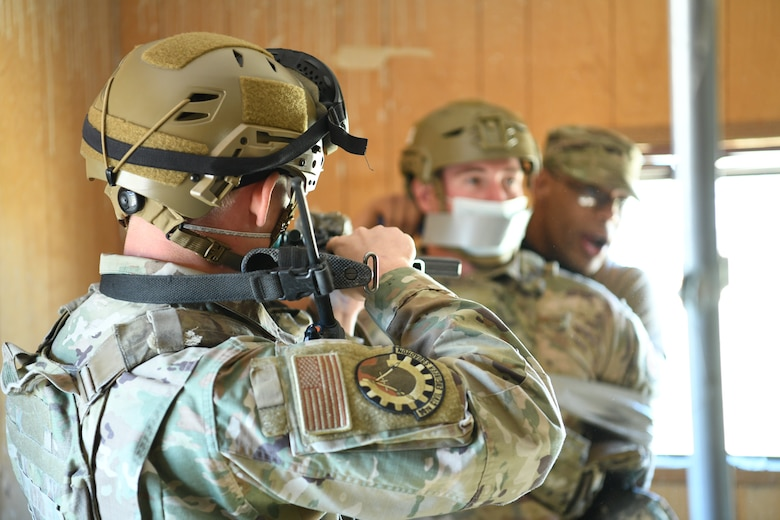Airmen training with weapons