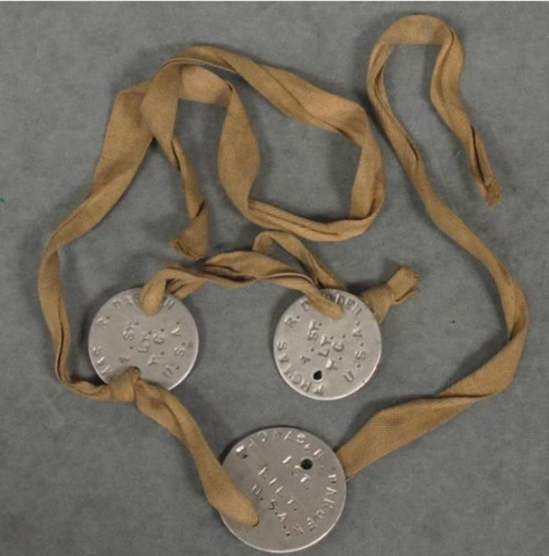 Three medal disks are each tied with a length of twill rope.
