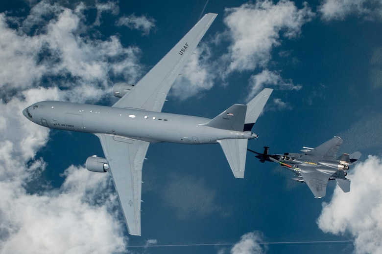 A KC-46 Pegasus from the 916th Air Refueling Wing in-air refuels an F-15E Strike Eagle from the 336th Fighter Squadron at Seymour Johnson Air Force Base over North Carolina.