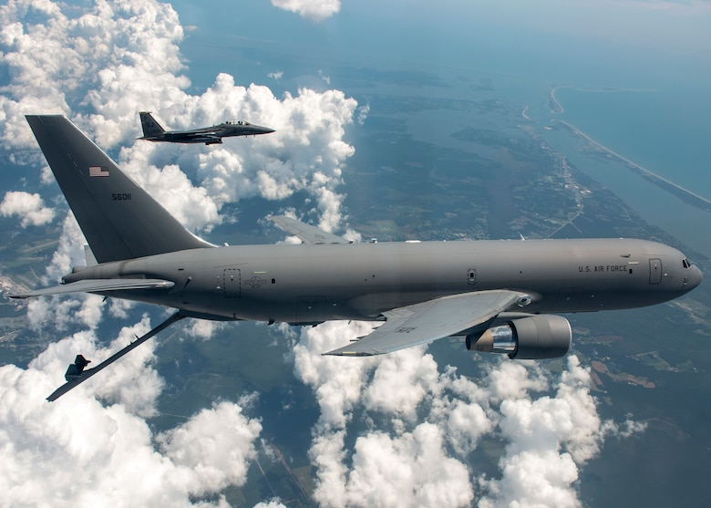 A KC-46 Pegasus from the 916th Air Refueling Wing and an F-15E Strike Eagle from the 336th Fighter Squadron at Seymour Johnson Air Force Base fly in the sky over North Carolina.