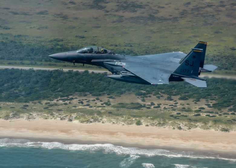 An F-15E Strike Eagle from the 336th Fighter Squadron at Seymour Johnson Air Force Base flies in the sky over the North Carolina coast.