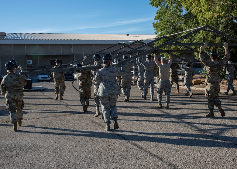 Airmen from the 366th Force Support Squadron move a tent base during a training exercise, Sept. 4, 2020, on Mountain Home Air Force Base, Idaho. The training is part of an annual pallet expeditionary kitchen set up exercise. (U.S. Air Force photo by Airman Andrea Rozoto)