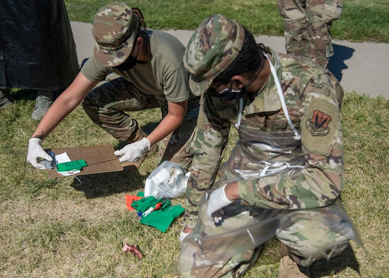 Airmen from the 366th Force Support Squadron tag and bag expired meat from the commissary during a training exercise, Sept. 4, 2020, on Mountain Home Air Force Base, Idaho. The training is part of an annual search and rescue exercise. (U.S. Air Force photo by Airman Andrea Rozoto)