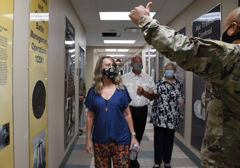 U.S. Air Force Maj. Donald Roley, 334th Training Squadron director of operations, provides Rhonda Cody, Gold Star Family Member, and her family with a tour inside Cody Hall at Keesler Air Force Base, Mississippi, Sept. 2, 2020. Cody's father, Capt. Howard Cody, was a senior pilot who was killed in action in South Vietnam in 1963. As surviving family members of a killed in action service member, they are allowed to obtain an ID card for recognition and installation access to attend events and access Airmen and Family Readiness Center referral services. (U.S. Air Force photo by Kemberly Groue)