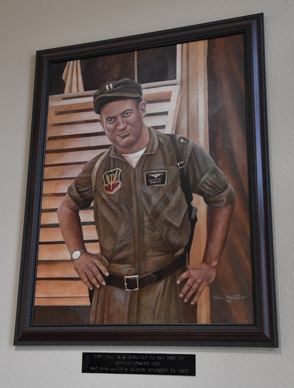 A painting of U.S. Air Force Capt. Howard Cody is on display inside Cody Hall at Keesler Air Force Base, Mississippi, Sept. 2, 2020. Cody was a senior pilot who was killed in action in South Vietnam in 1963. (U.S. Air Force photo by Kemberly Groue)