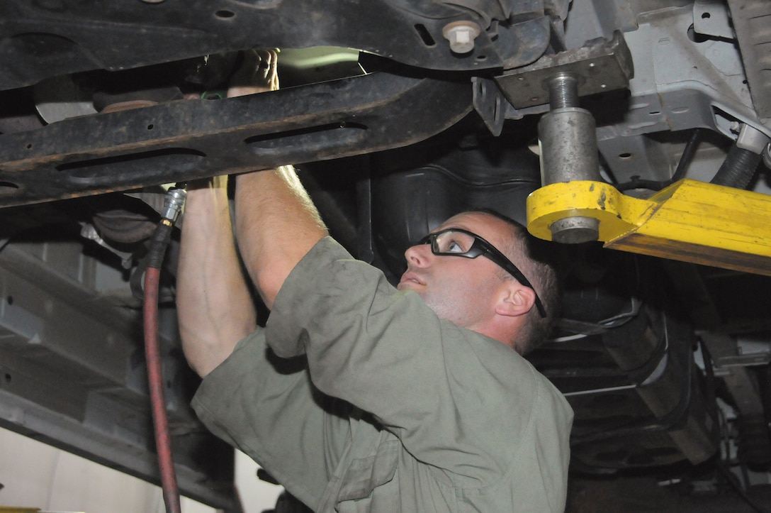 Tech. Sgt. Taylor Harnist, vehicle maintenance journeyman with the 445th Logistics Readiness Squadron, repairs a vehicle at Germain Ford of Beavercreek. Germain Ford established a program with LRS to provide hands-on training to LRS Airmen.