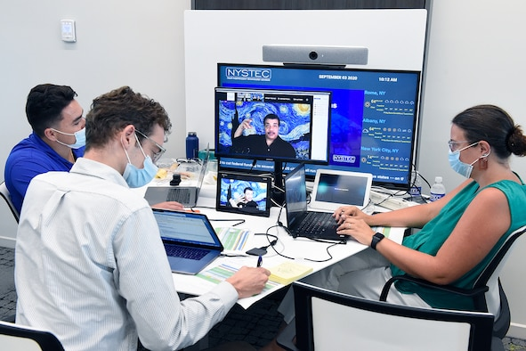 Production Team broadcasting keynote with Dr. Neil deGrasse Tyson. (Courtesy photo)