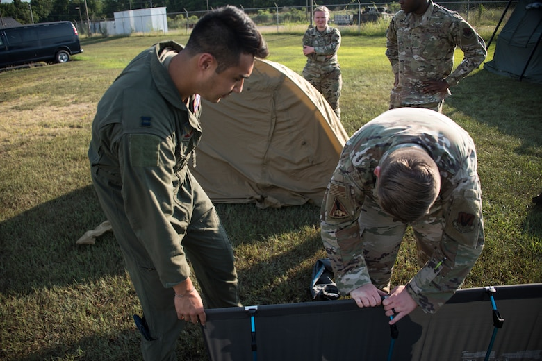 A photo of Airmen setting up equipment
