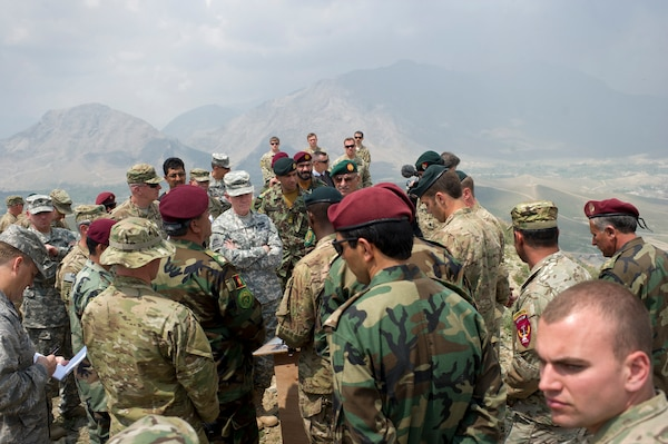 General Martin E. Dempsey, then Chairman of the Joint Chiefs of Staff, center, listens to briefing from U.S. and Afghan special operations forces at Camp Morehead, Afghanistan, April 23, 2012 (DOD/D. Myles Cullen)