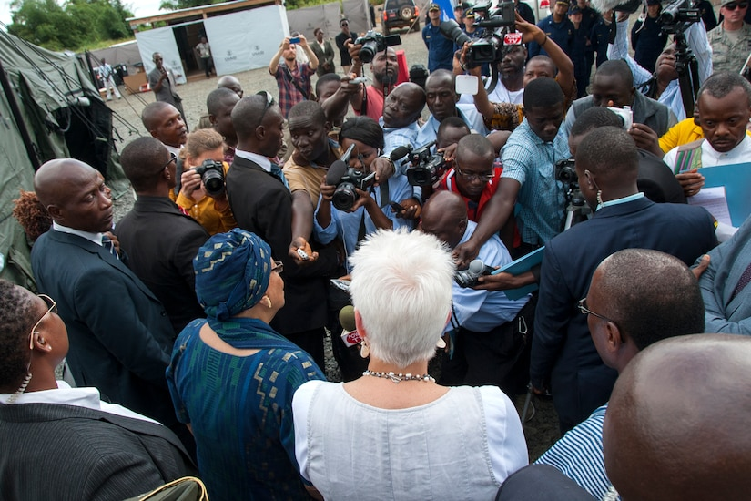 U.S. Ambassador to Liberia Deborah Malac, in white, and president of Liberia Ellen Johnson Sirleaf, left, speak to reporters after touring Ebola treatment unit built to care for medical workers who become infected while treating Ebola patients, in Harbel, Liberia, November 5, 2014 (U.S. Army/Nathan Hoskins)