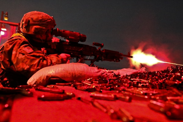 Soldier assigned to 182nd Transportation Company fires M240B machine gun as part of Operation ROM, hosted by 79th Theater