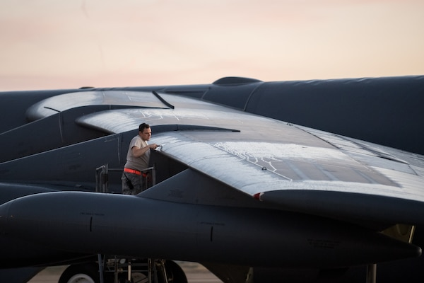 Airman changes light on wing of B-52 Stratofortress during annual command and control exercise Global Thunder 2019, at